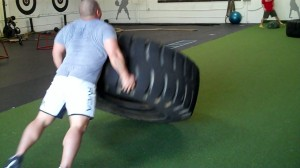 flipping a tire, strength, strong, stronger, innovative results gym