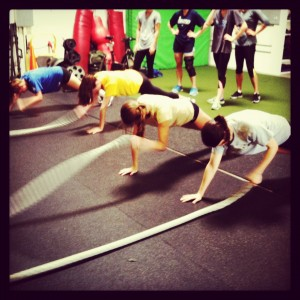 boot camp exercises - plank waves with the rope