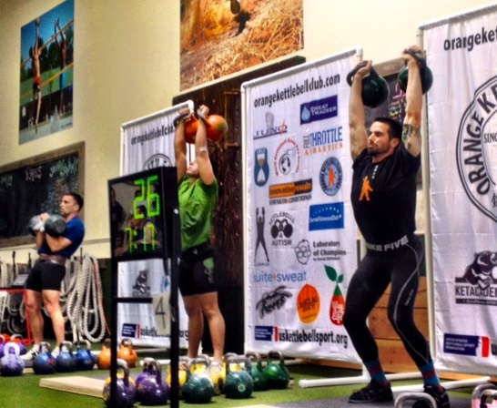 Aaron is an American Record holder for the jerk and snatch with a 24kg kettlebell.