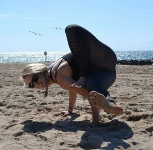 Yoga demonstrates her strength and flexibility through yoga at the beach, and at Innovative Results.