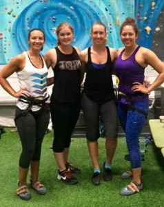 alex calvillo with three other girls at climbing gym